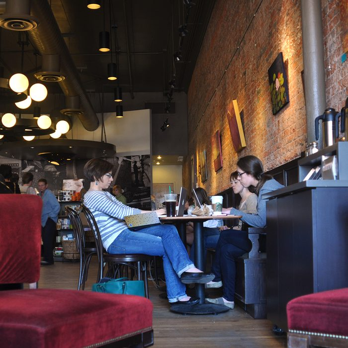 SANTA FE, NM - MARCH 10, 2013: Customers relax and work their laptop computers at a Starbucks coffee shop near the Plaza Santa Fe, New Mexico.