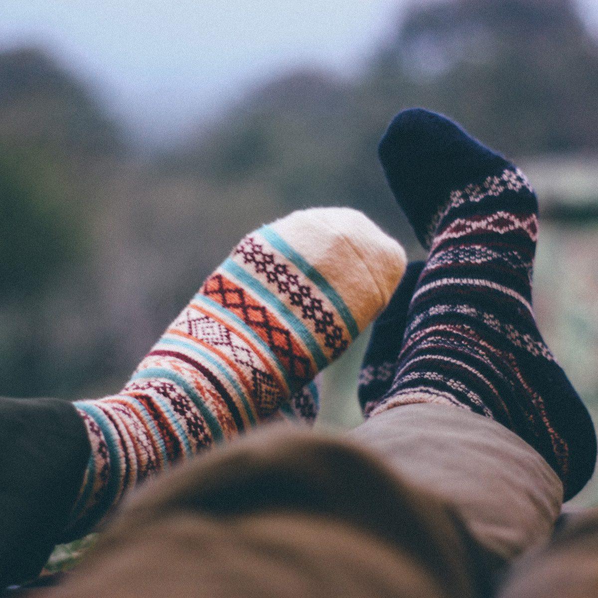 Low Section Of People Wearing Socks Against Defocused Background