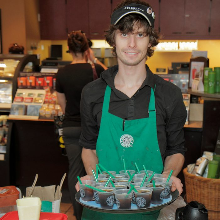 A man offering free samples at Starbucks on Market Street. (Photo by: Jeffrey Greenberg/Universal Images Group via Getty Images)