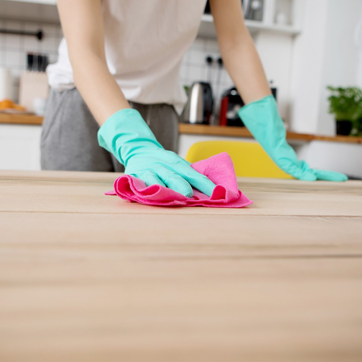 Young woman is cleaning the kitchen in home.