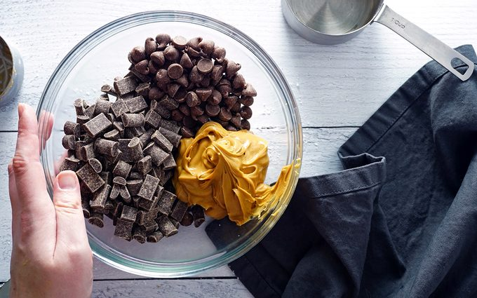 peanut butter cup chocolate layer ingredients in a bowl