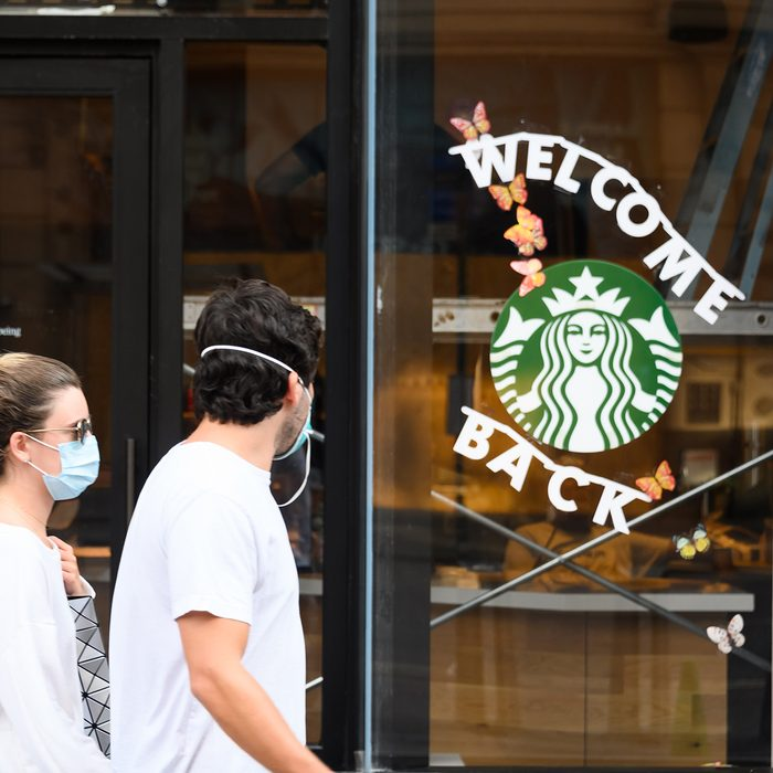 NEW YORK, NEW YORK - JUNE 23: People wear protective face masks outside Starbucks in midtown as the city moves into Phase 2 of re-opening following restrictions imposed to curb the coronavirus pandemic on June 23, 2020 in New York City. Phase 2 permits the reopening of offices, in-store retail, outdoor dining, barbers and beauty parlors and numerous other businesses. Phase 2 is the second of four-phased stages designated by the state. (Photo by Noam Galai/Getty Images)