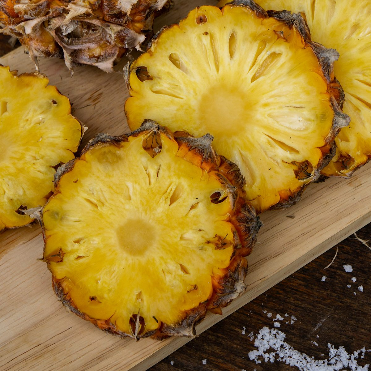 High Angle View Of Pineapple Slices On Cutting Board