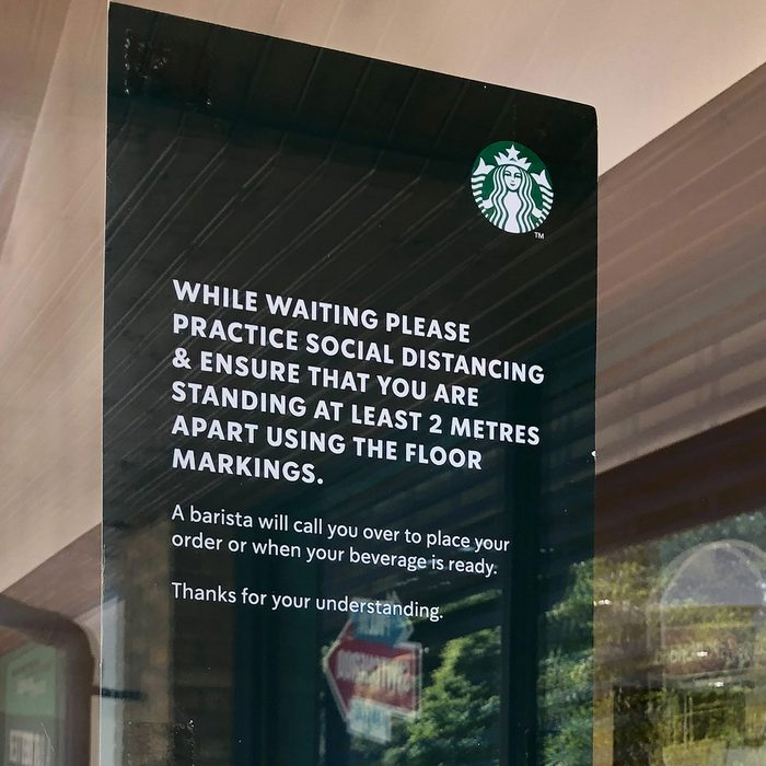 SOUTHAMPTON, ENGLAND - MAY 15: (EDITORS NOTE - This image was taken on a mobile phone) A sign encouraging social distancing is seen on a window of Starbucks in Hedge End as it re-opens on May 15, 2020 in Southampton, England. The prime minister announced the general contours of a phased exit from the current lockdown, adopted nearly two months ago in an effort curb the spread of Covid-19. (Photo by Naomi Baker/Getty Images)