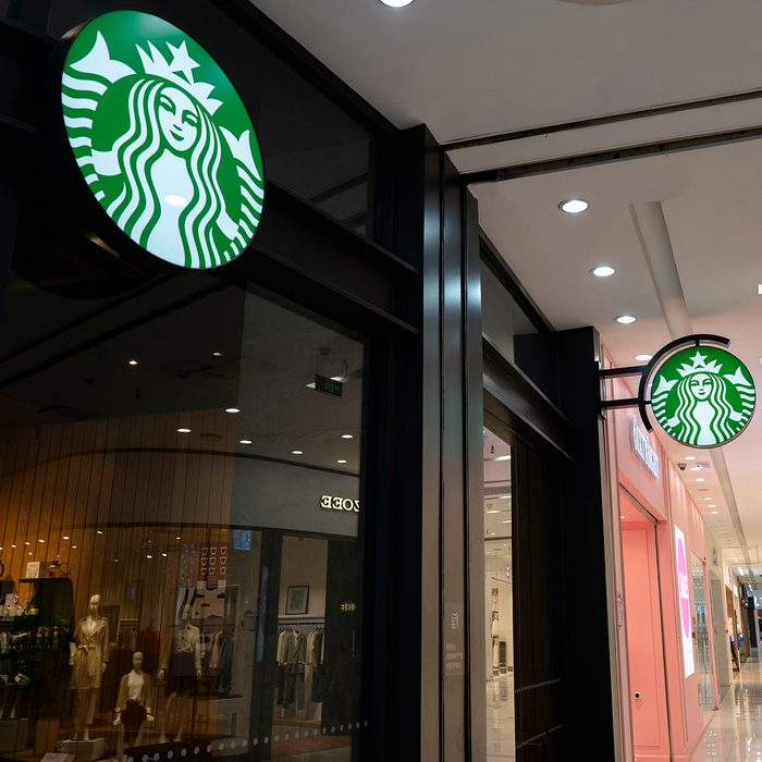 TIANJIN, CHINA - 2020/03/22: A Starbucks coffee store in a shopping mall. After nearly two months of closure by the COVID-19 epidemic situation in China, the Starbucks reopened most of stores in China. Customers are asked to take a temperature check before entering the store, and seated one people one table when dining in the store, otherwise encouraged to take out.