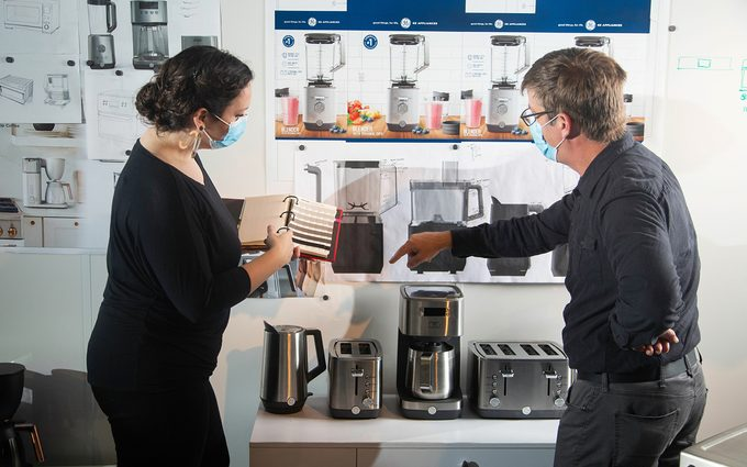 Consultant helping a customer select an appliance