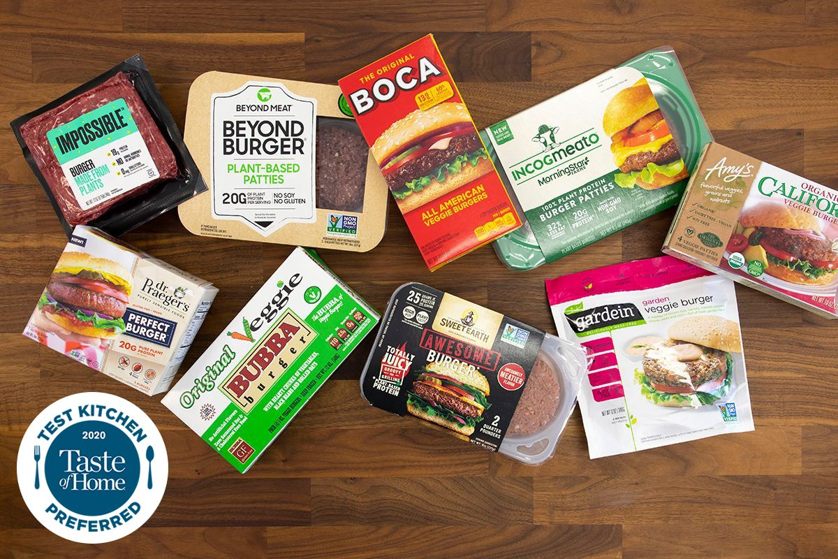 Plant-based burgers overhead on butcher block; TKP WITH LOGO