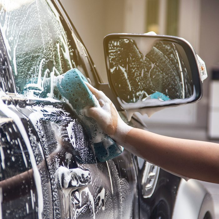 Cropped Hand Cleaning Car