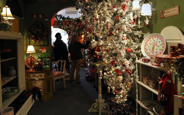 MANASSAS VA - DECEMBER 14: Hazel Colson from Stafford VA looks at items at The Things I Love store, which has 25 Christmas trees up, including this upside down tree. It has become an attraction to visitors all over the region. People shop on December 14, 2010. (Photo by Carol Guzy/The Washington Post via Getty Images )