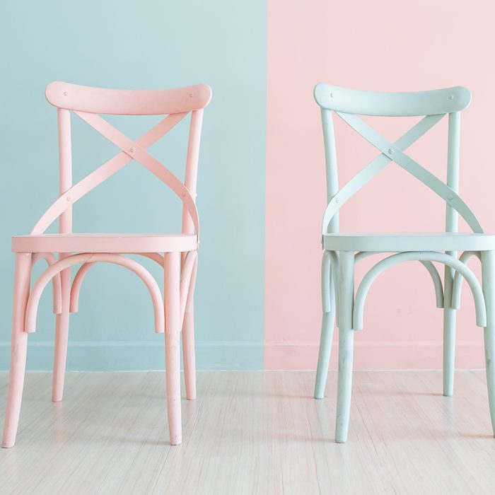 Vintage pastel horizontal wooden chair painted on two tone background; Shutterstock ID 735907939; job: Job (RD)