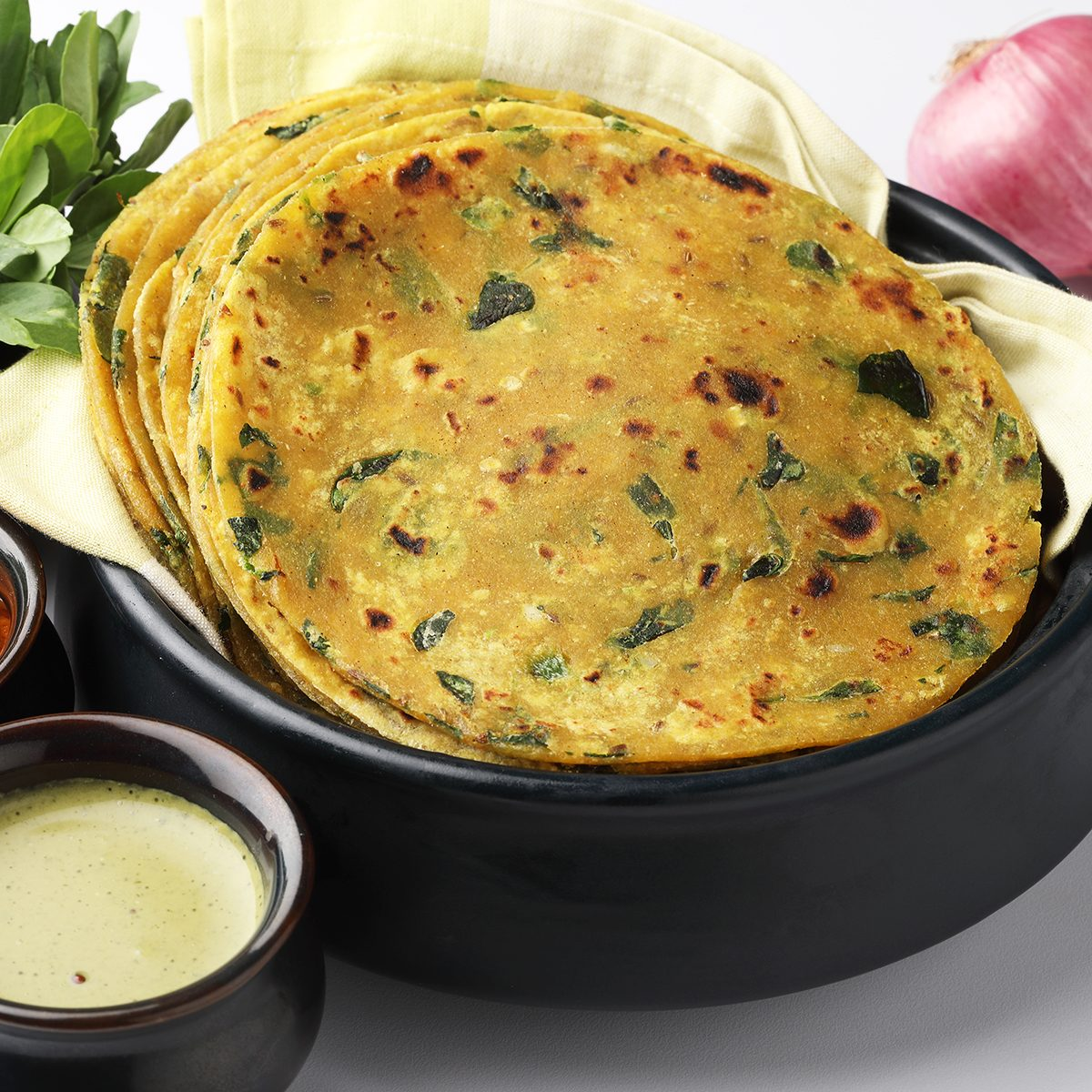 Methi Paratha (Thepla) / Indian flat bread using fenugreek leaves, served with mint dip,yogurt.