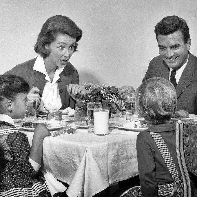 1960s FAMILY OF FOUR EATING DINNER TOGETHER (Photo by H. Armstrong Roberts/ClassicStock/Getty Images)