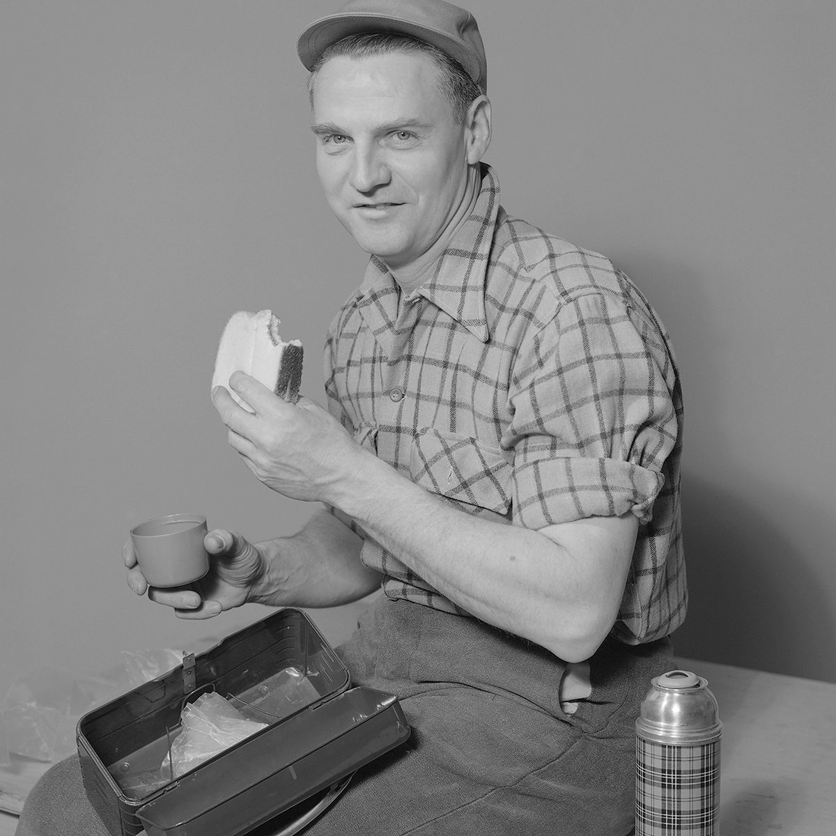 Portrait Of Man Eating Bread Slice. (Photo by Lambert/Getty Images)