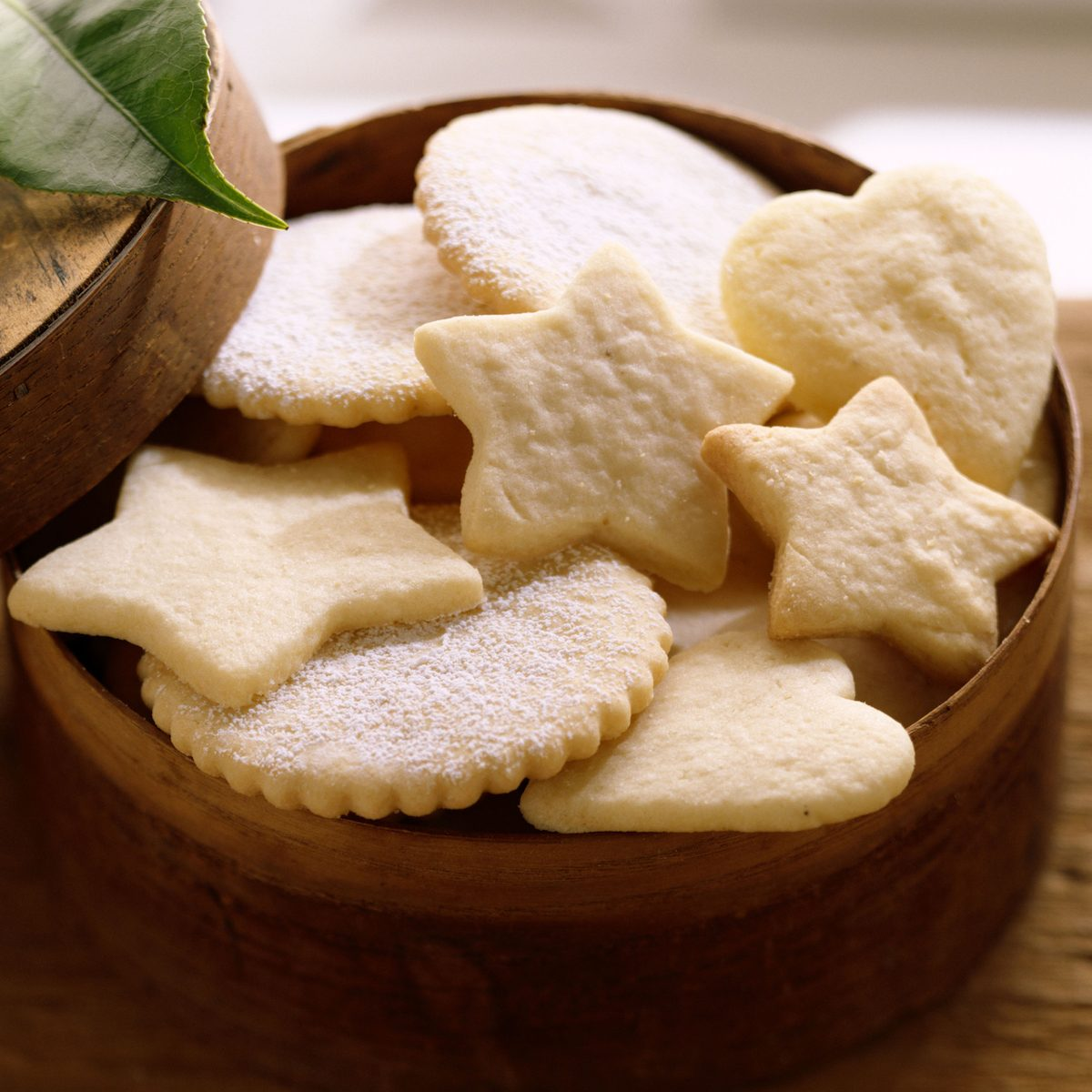 Assorted unfrosted sugar cookies in a round box.