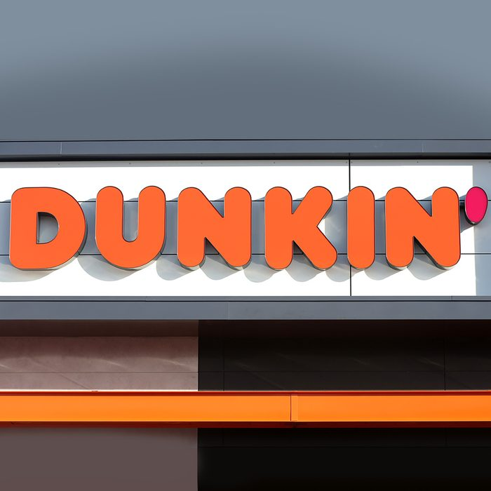 """QUINCY, MA - JANUARY 16: A sign outside the new Dunkin' store in Quincy, MA is pictured on Jan. 16, 2018. The famed local chain debuted the new store with """"Donuts"""" removed from its name. Located about 1 mile from where the first one opened in Quincy 68 years ago, this one is decidedly more modern, with an open layout and more natural lighting, a grab-and-go station with healthier options, pickup stations for orders via the mobile app, and eventually, digital kiosks for ordering. (Photo by David L. Ryan/The Boston Globe via Getty Images)"""