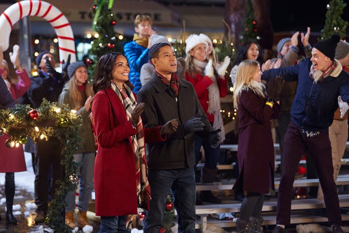Erin is planning the town's Christmas celebration and must win over firefighter Kevin in order to obtain the beautiful spruce tree on his property for the celebration. Photo: Rochelle Aytes, Mark Taylor Credit: ©2020 Crown Media United States LLC/Photographer:Ryan Plummer
