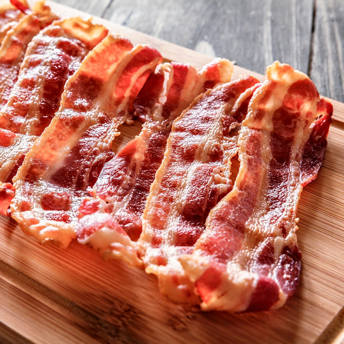 "Roasted bacon on cutting board. Ingredient used in making Jam Bread or ""Pan de Jamon"" a Venezuelan Christmas food."