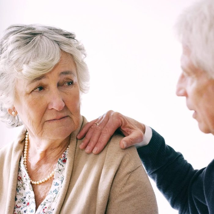 Shot of a senior man comforting his wife at during a conversation at home