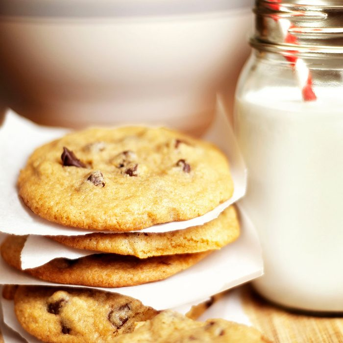 Close-up of cookies and milk on table