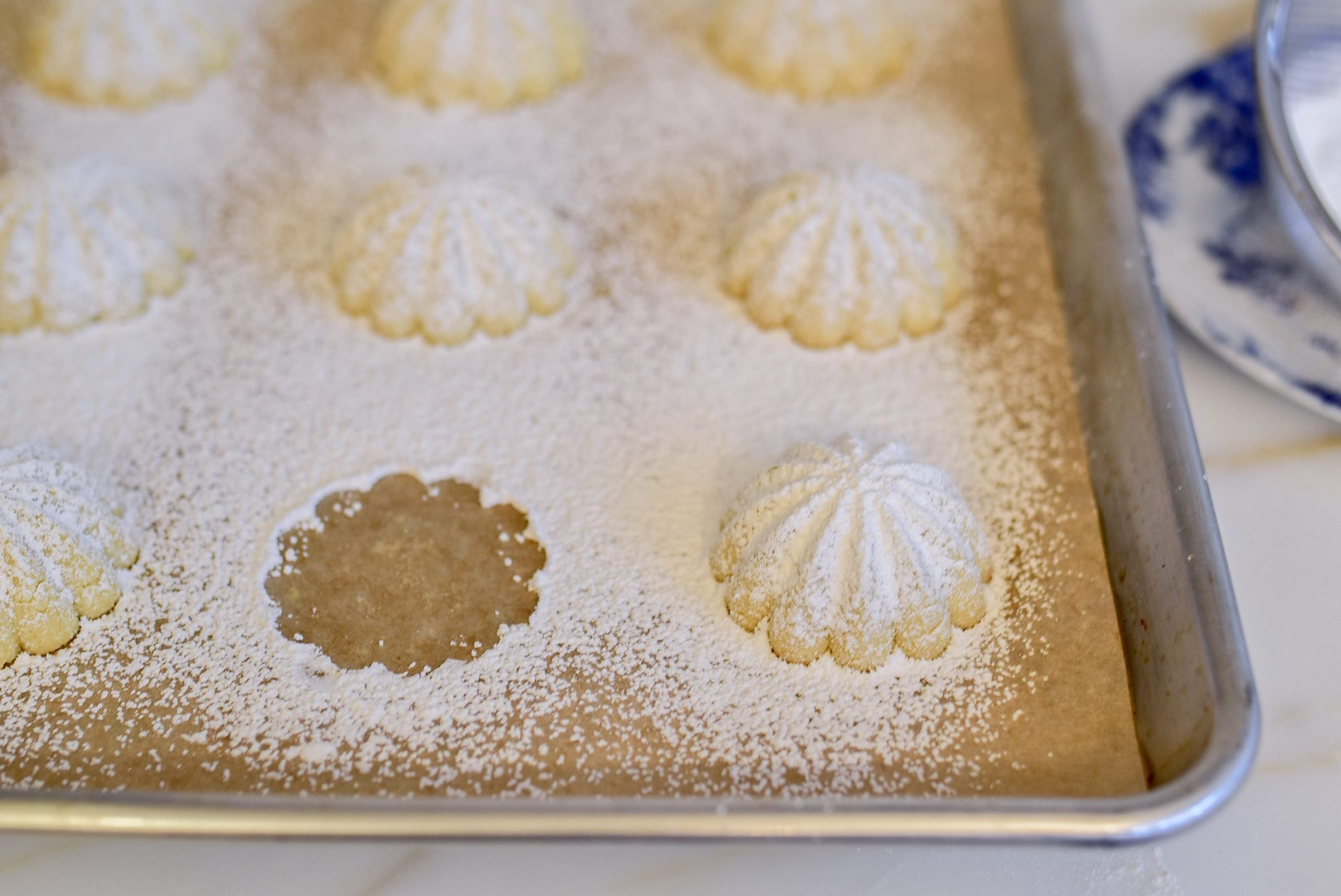 Semolina Ma'amoul on a sheet pan with one missing