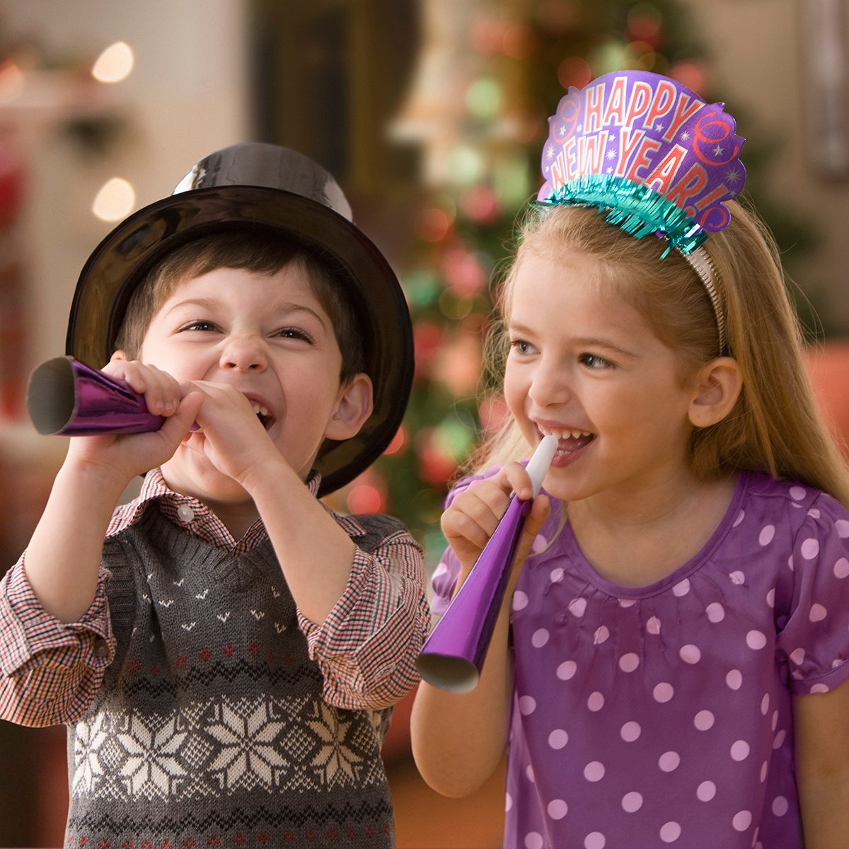 Boy and girl celebrating New Year's Eve