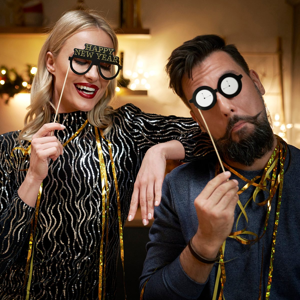 Couple have fun during making New Year's Eve photo booths