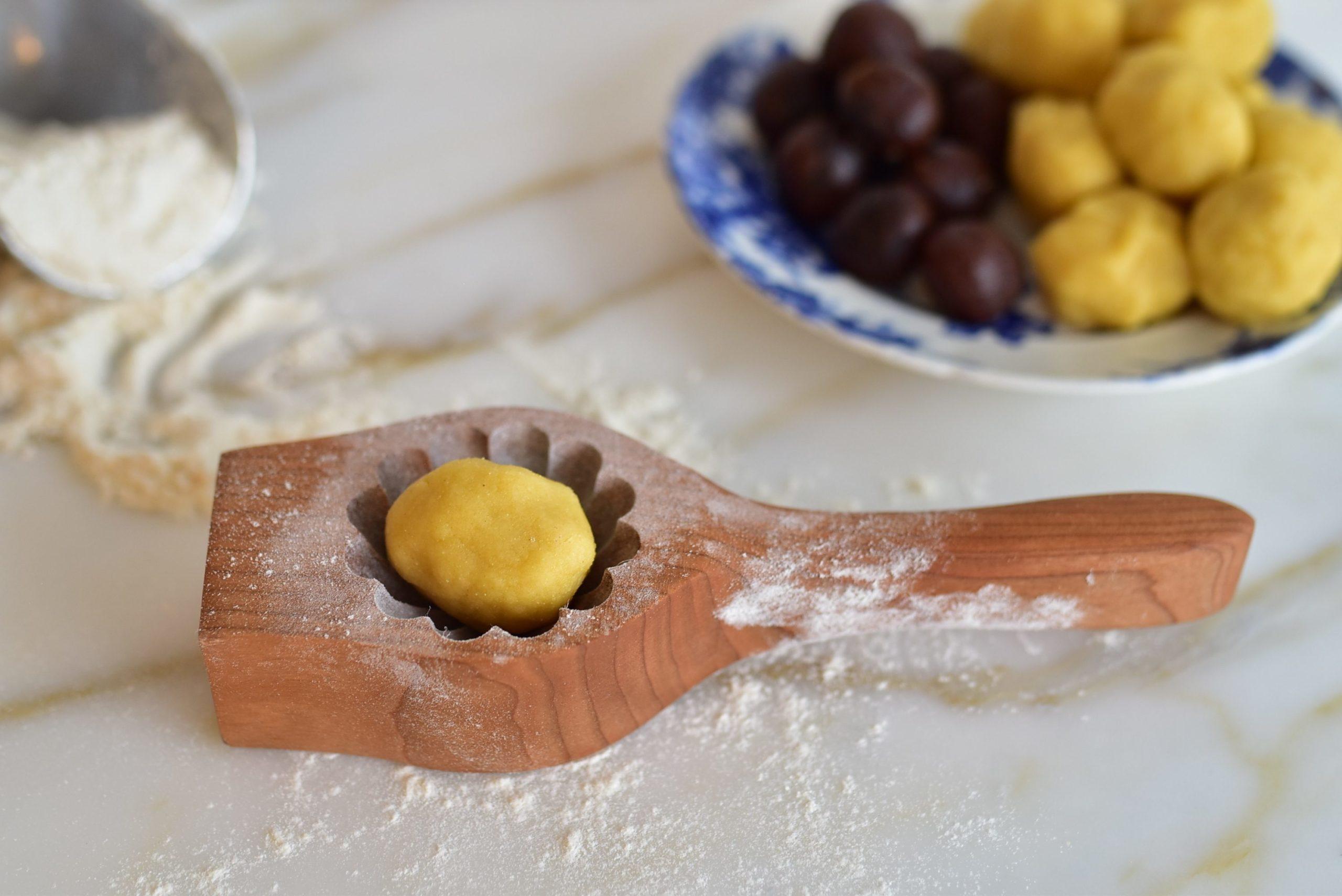 Ma'amoul dough ball in a ma'amoul cookie mold