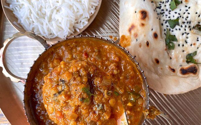 A platter of Dal, rice, & naan