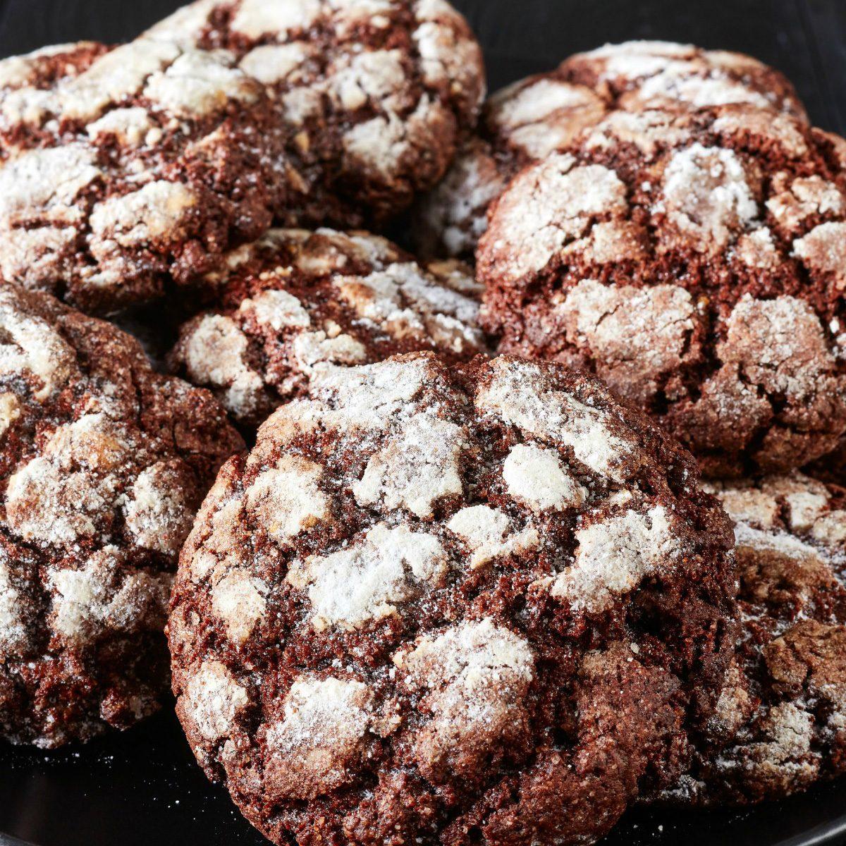 A pile of sugar-free, keto chocolate crinkle cookies.