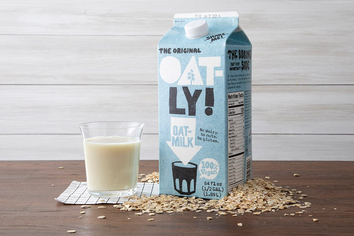 Oatly Oat Milk With Glass And Oats