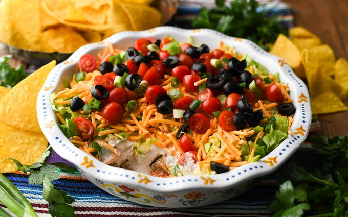Serve the taco dip with tortilla chips and enjoy! how to make taco dip