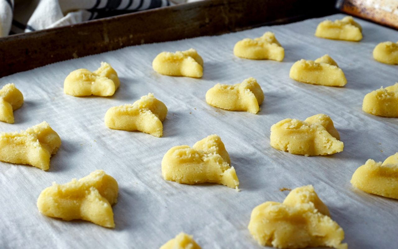 heart-pressed cookies on baking sheet how to make butter cookies