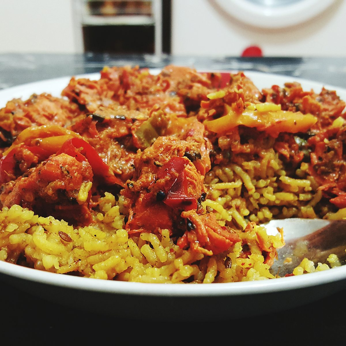 indian main dishes Chicken Jalfrezi And Basmati Rice Served In Plate On Table