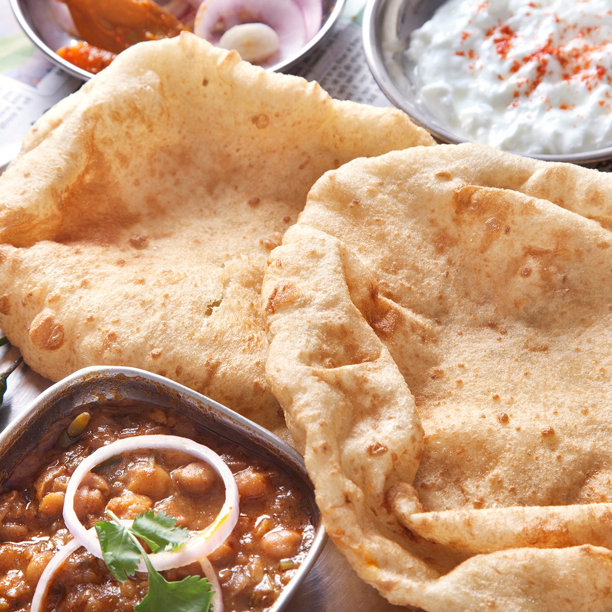 indian main dishes Close Up Chole Bhature Served At Table