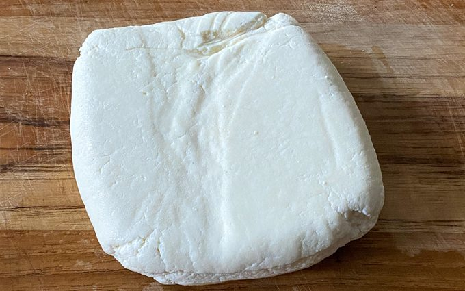 firm and set paneer on a cutting board
