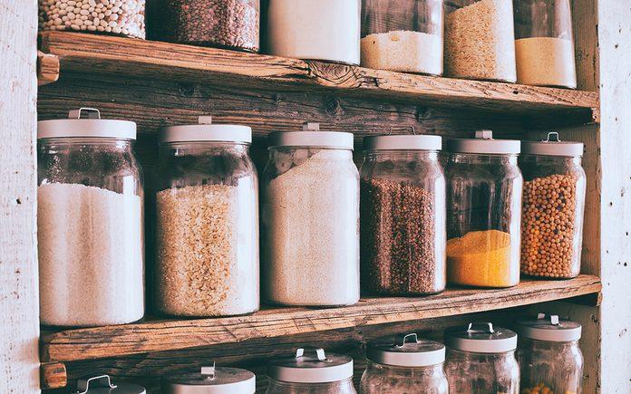 healthy pantry staples Jars Of Ingredients On Wooden Shelves