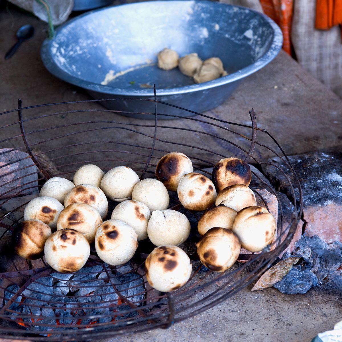 indian main dishes Litti Bihari Food Backed In Coal Fire, India