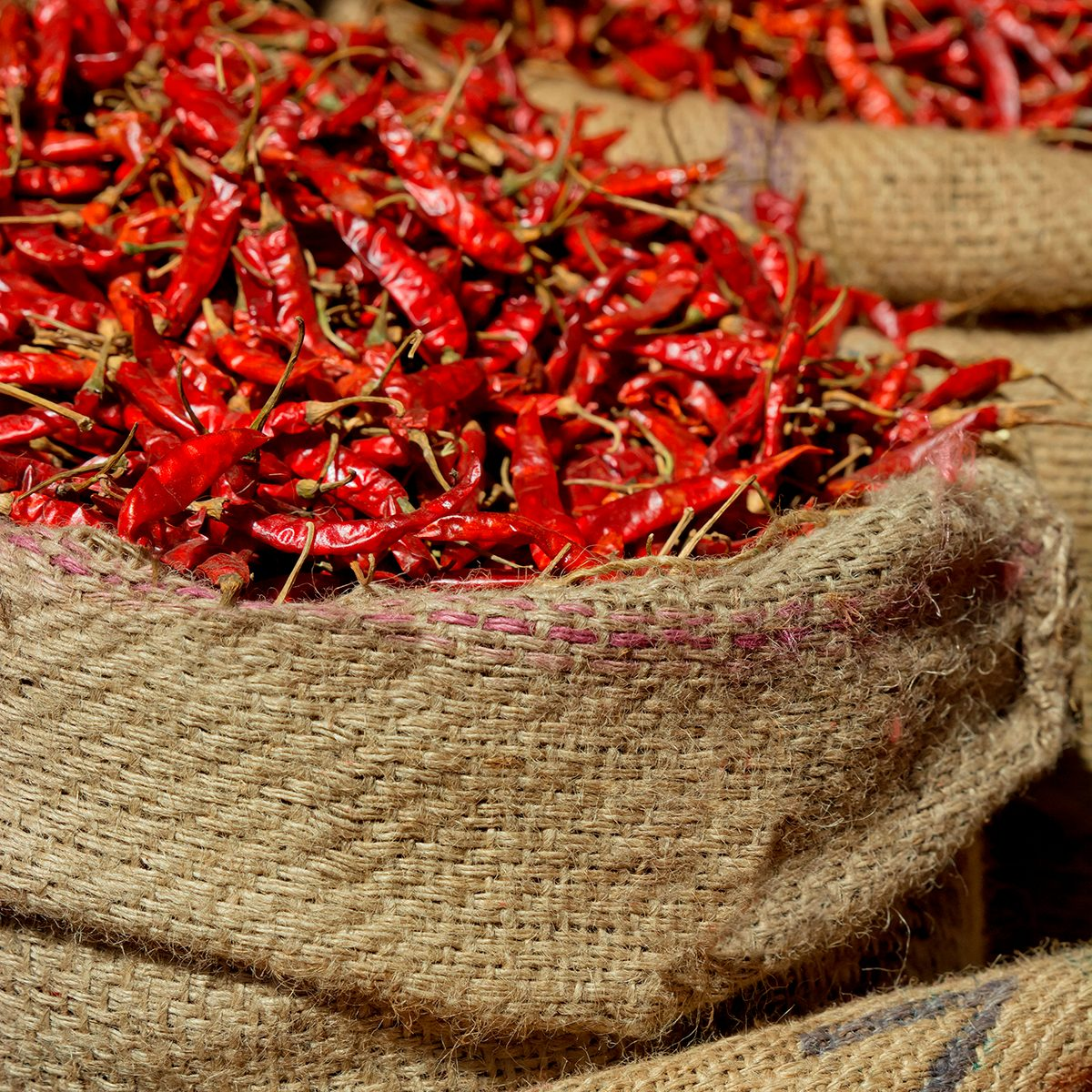 indian spices Red Dried Chili Peppers For Sale At Market. India. (Photo by: Madhurima Sil/IndiaPictures/Universal Images Group via Getty Images)