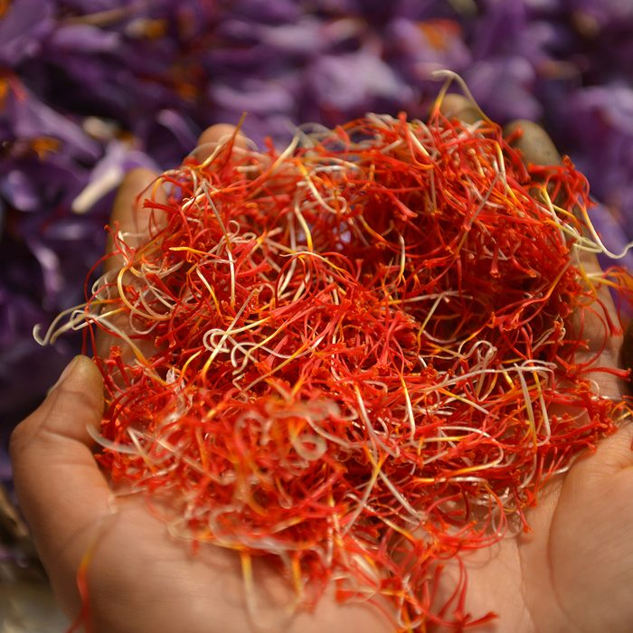 indian spices A Kashmiri farmer shows saffron petals after being picked from flowers at a farm in Pampore, south of Srinagar on November 1, 2016. - Kashmir is one of the few places in the world, where the world's most expensive spice grows. It is used as a flavouring and colouring agent in many recipes. (Photo by TAUSEEF MUSTAFA / AFP) (Photo credit should read TAUSEEF MUSTAFA/AFP via Getty Images)