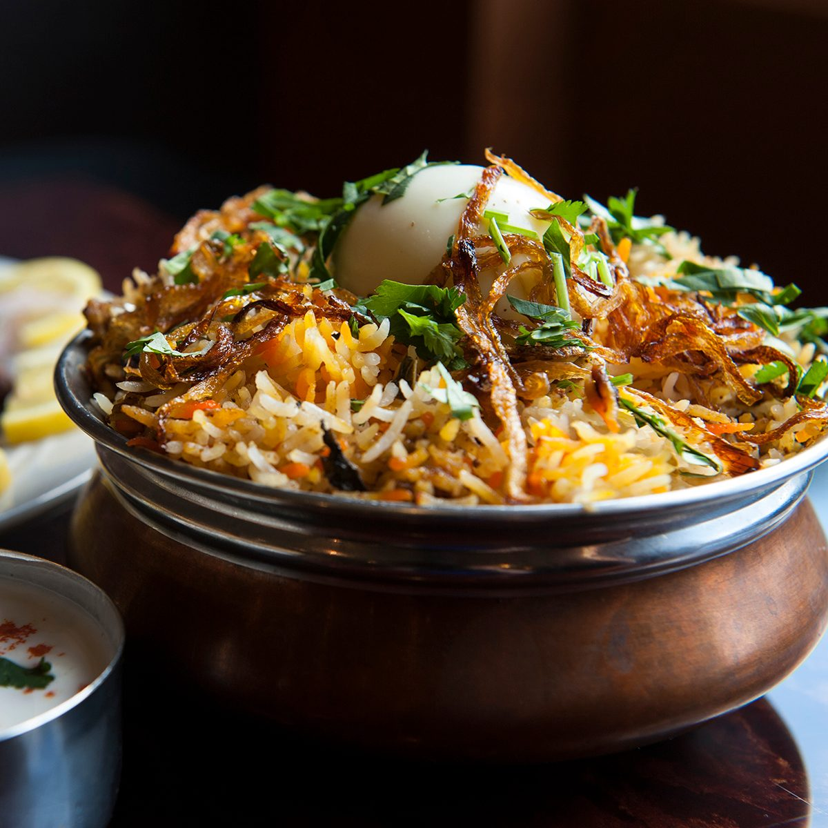 The hyderabadi chicken biryani is photographed at Akshaya Thursday May 9, 2013 in Sterling, VA. The restaurant features the Indo-Chinese cuisine. In the background at left is the lamb pepper fry.