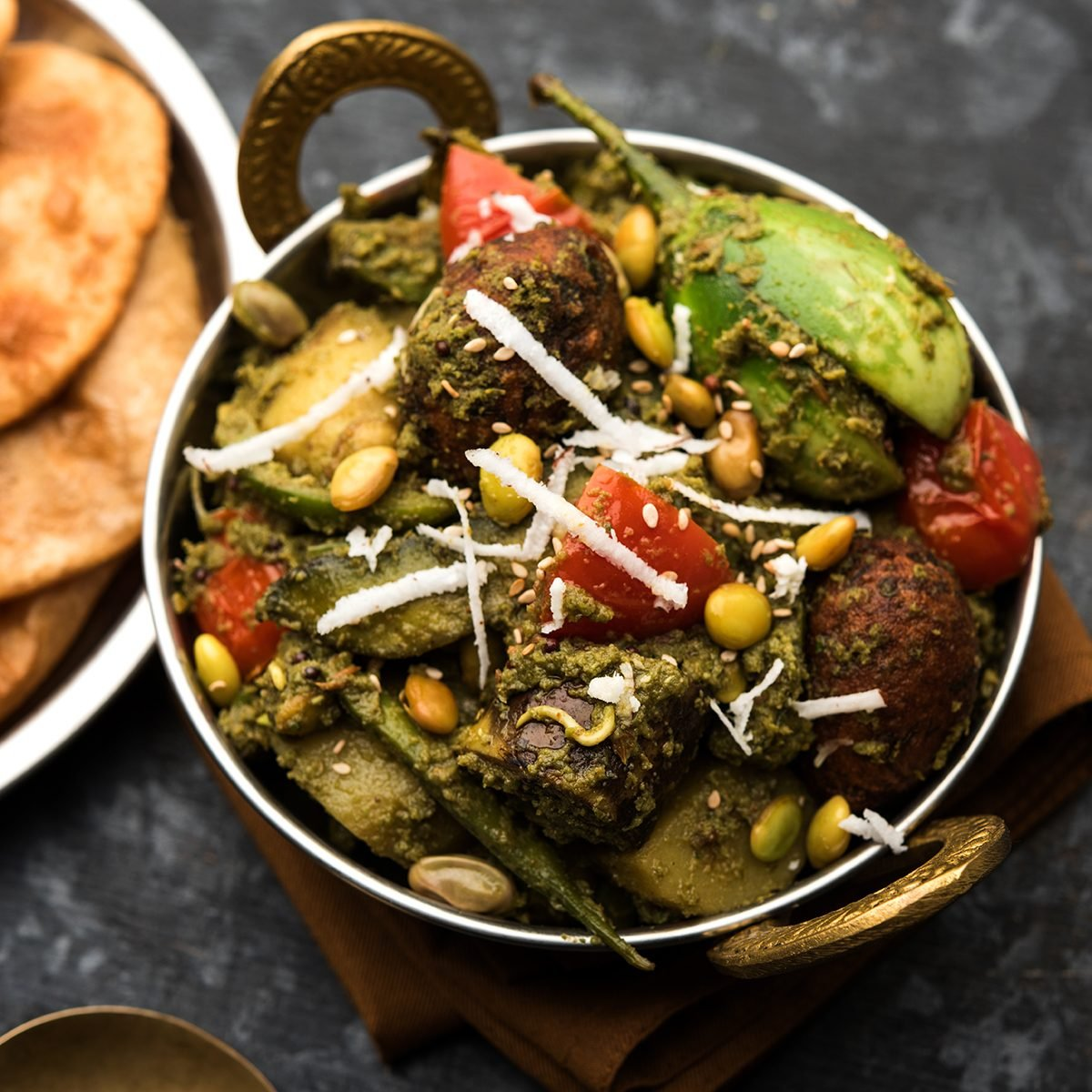 indian main dishes Undhiyu Is A Gujarati Mixed Vegetable Dish, Specialty Of Surat, India. Served In A Bowl With Or Without Poori