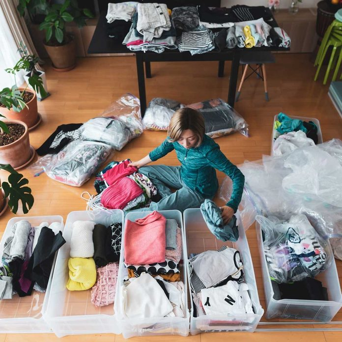 Woman Organizing Clothes Gettyimages 1221702981
