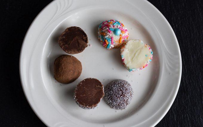 Three chocolate truffles cut in half. How To Make Chocolate Truffles.toh.nancy Mock 15