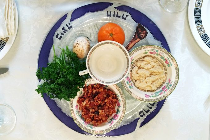 A Passover seder plate that includes an orange, which is a feminist and LGBTQ-friendly Passover tradition.