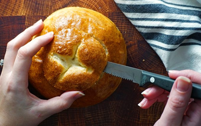 cut a small, angled circle from the top of each bread bowl copycat panera bread bowl