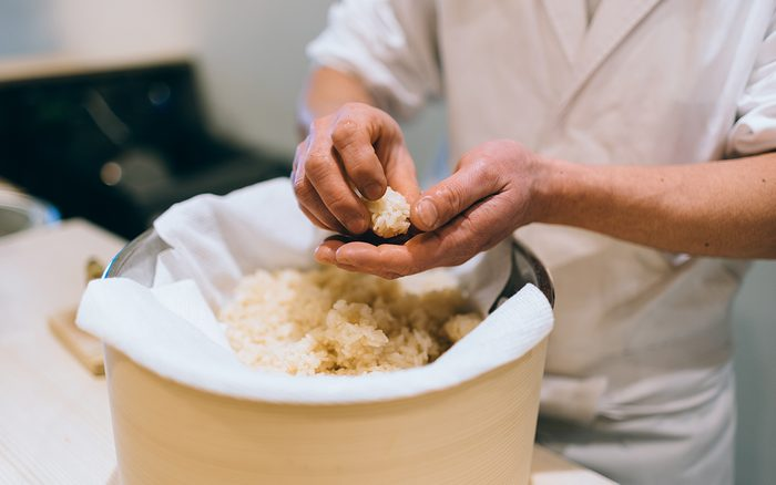 how to make sushi rice Sushi Chef Making Artisanal Nigiri Zushi At Bar, Tsukiji