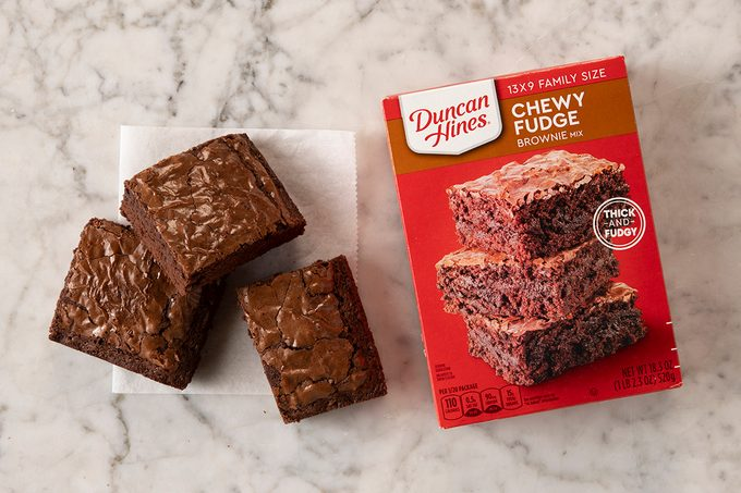 Duncan Hines Chewy Fudge Brownie Mix In Package On Marble With Pieces