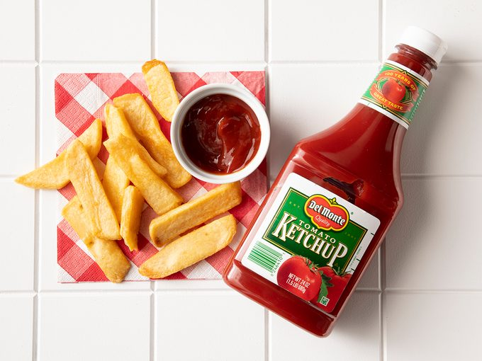 Overhead Shot Of Del Monte Ketchup In Bottle With Fries.
