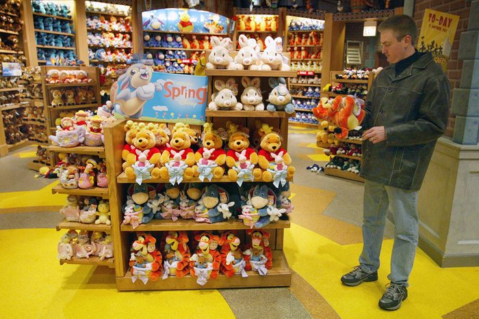 CHICAGO - MARCH 15: A man shops for items in a Disney Store March 15, 2004 in Chicago, Illinois. Disney is still planning to sell two money losing ventures, the Disney Stores and the Mighty Ducks hockey team. (Photo by Tim Boyle/Getty Images)