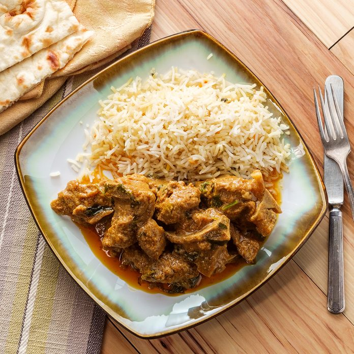 traditional jamaican foods Authentic Indian goat korma curry with jasmine rice